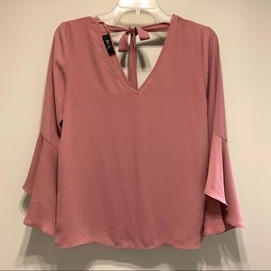 Pink flowy top with bow